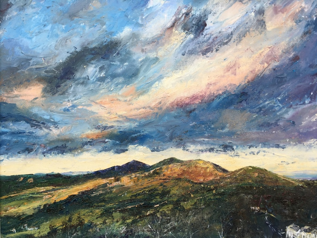 January skies, Malvern hills viewed from British Camp. Oil painting by contemporary artist Anna Cumming